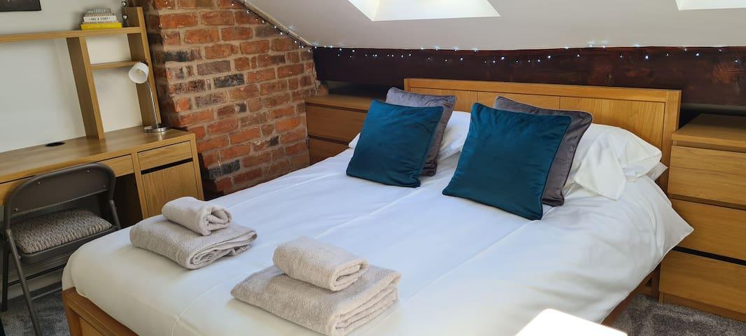 Double bed in loft room