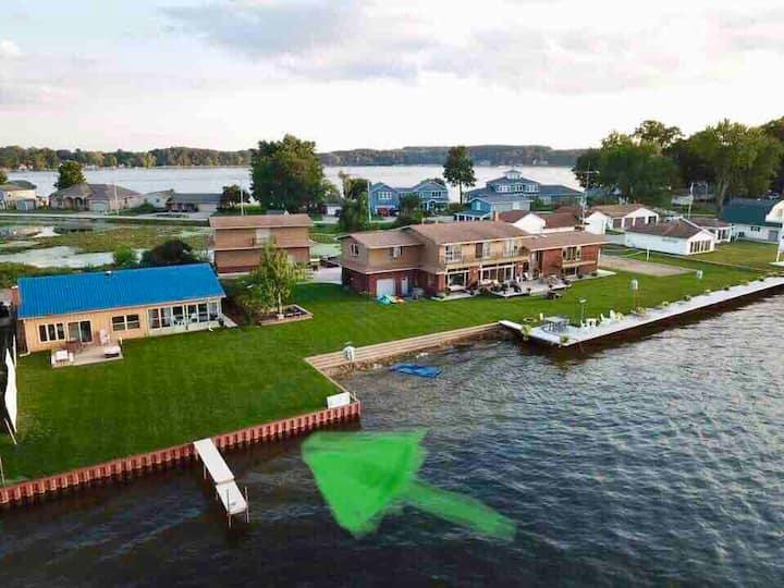 Lakefront, private beach, spacious yard.