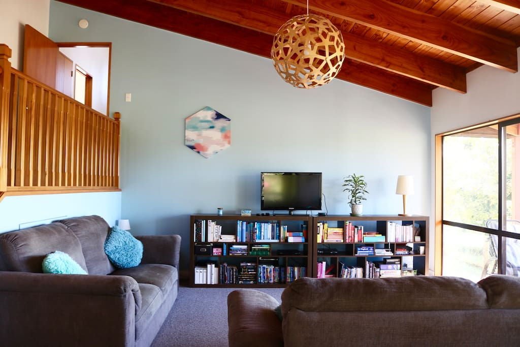 Open living area with gorgeous exposed wooden beams