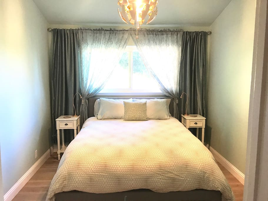 Private guest room with queen bed.