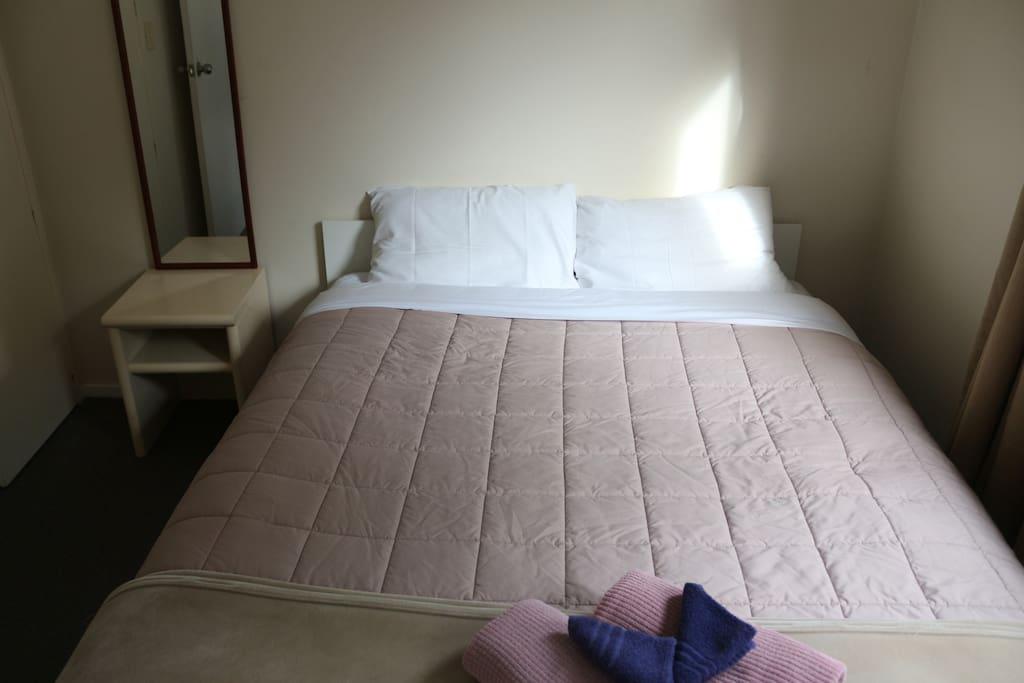 Room 1 queen bed.