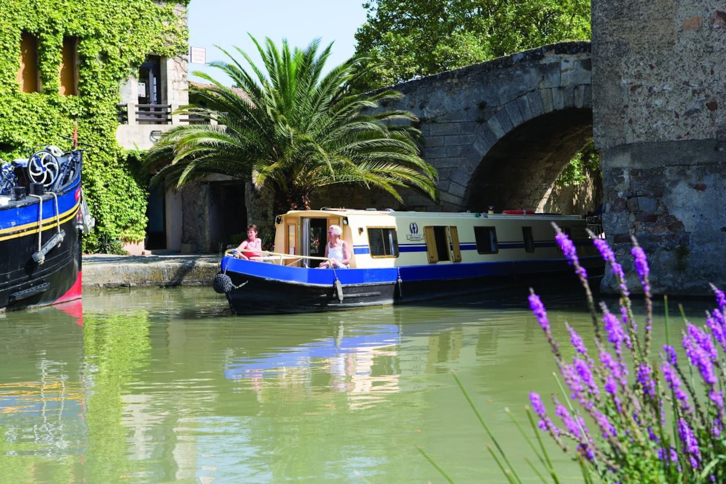 Our English Narrowboat passing under the bridge in Le Somail