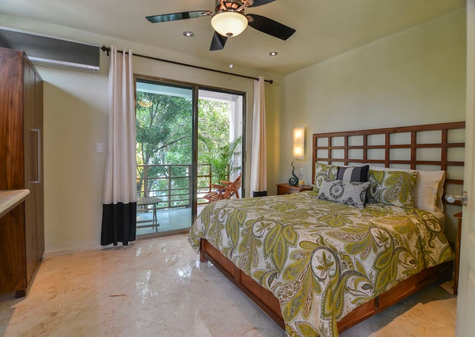 The third floor bedroom features a queen sized bed and a heavenly patio perfect for morning coffee.