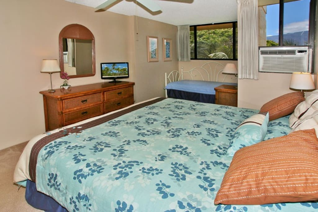 Bedroom includes a king size bed and a twin day bed