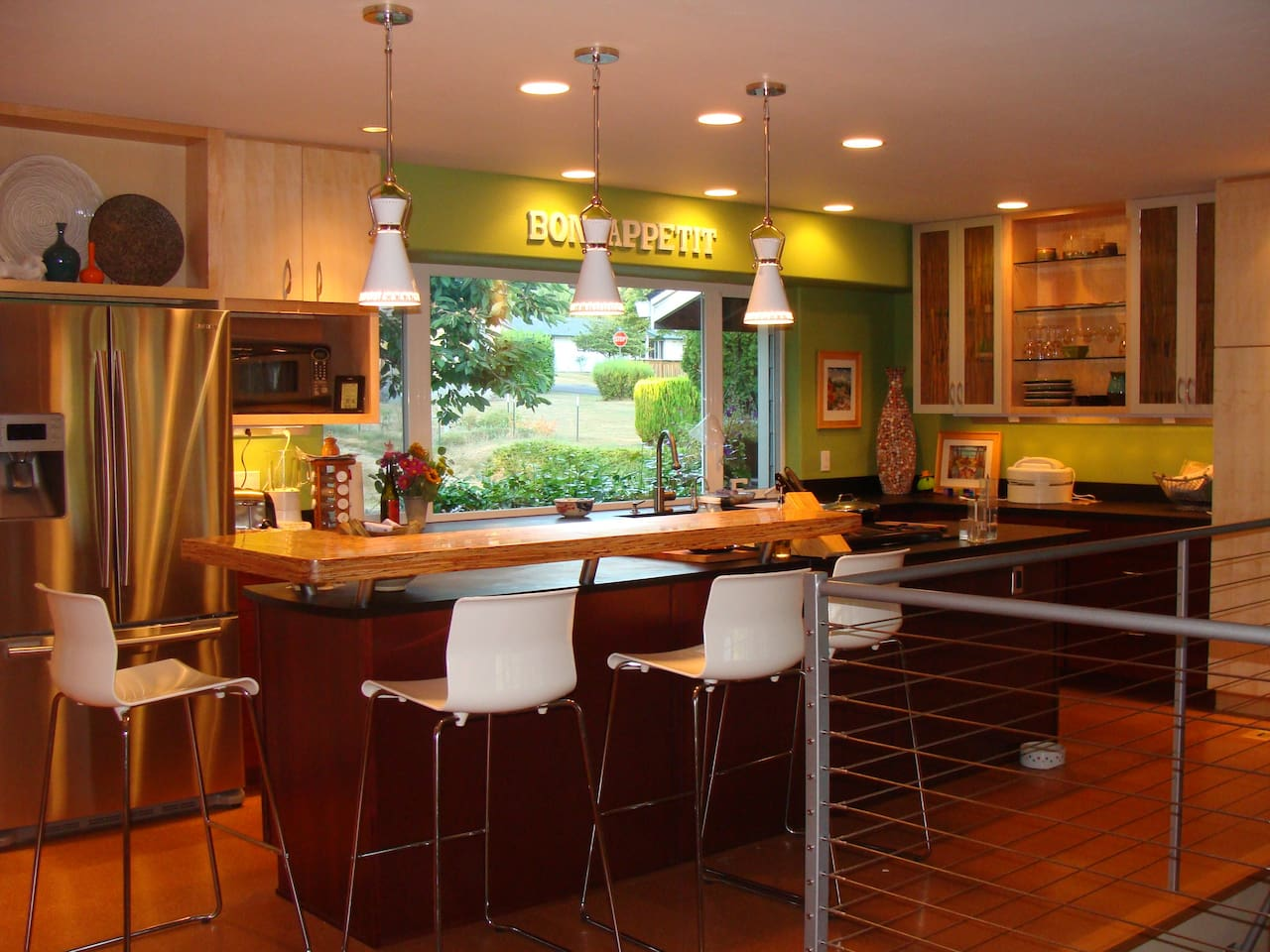 Modern galley-style kitchen with breakfast bar that includes seating for 4.