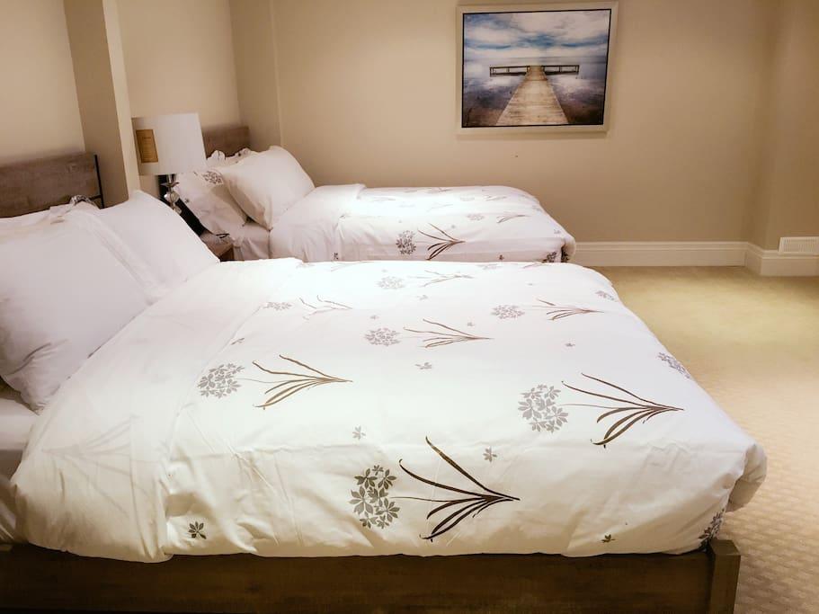 Bedroom 1 with two queen beds.
