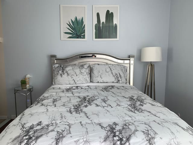 Bed with nightstand and lamp.