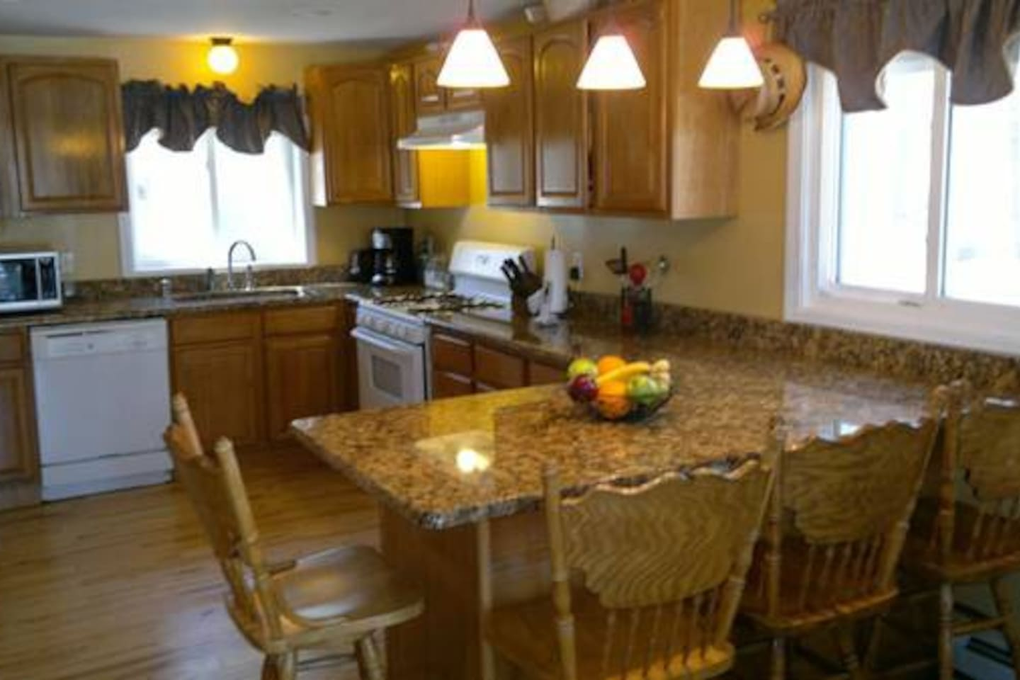 Full equipped kitchen with breakfast bar and granite counters.