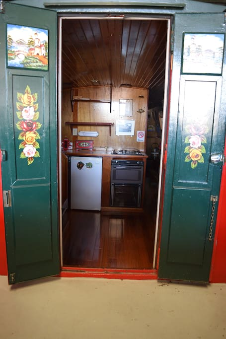 Entry from the bow of the boat brings you directly to the kitchen area.