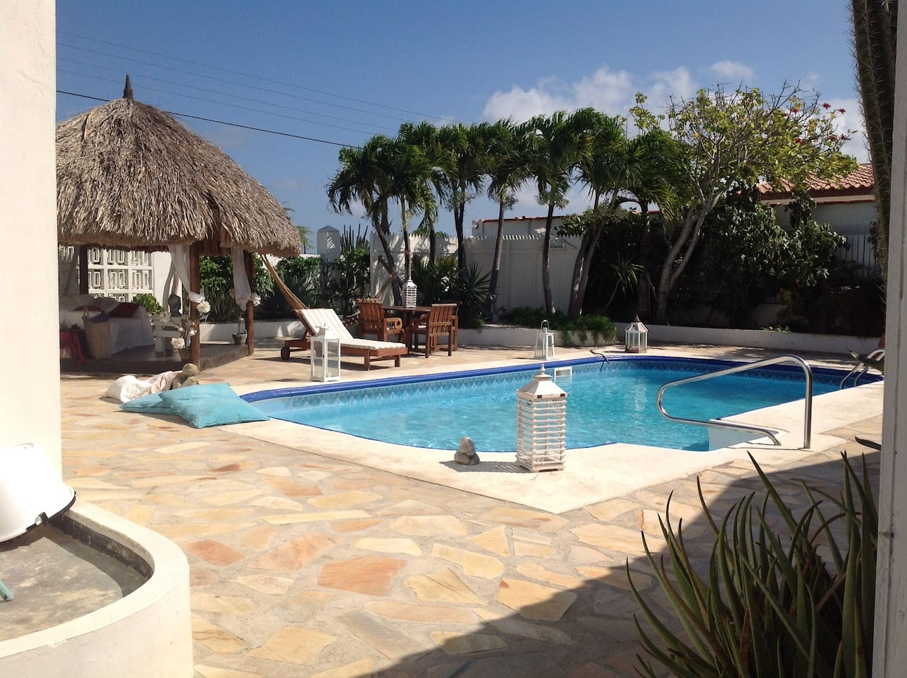 Pool at La Casita with gazebo and long chairs to relax