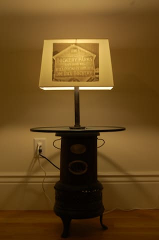 We make most of our own lighting.  This is an old kerosene stove with pictures of a trip to Mississippi.