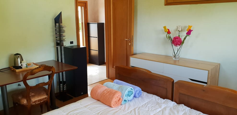 Bedroom with table and wardrobe
