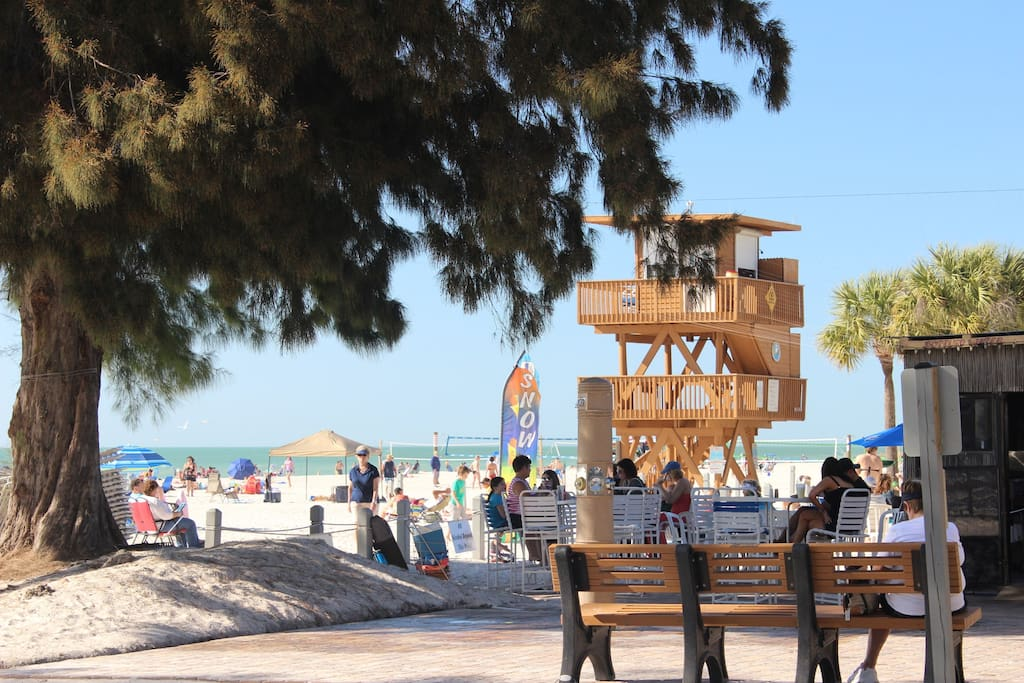 Bradenton Beach with lifeguards on duty, bathrooms, shower, restaurant, volleyball and playground.