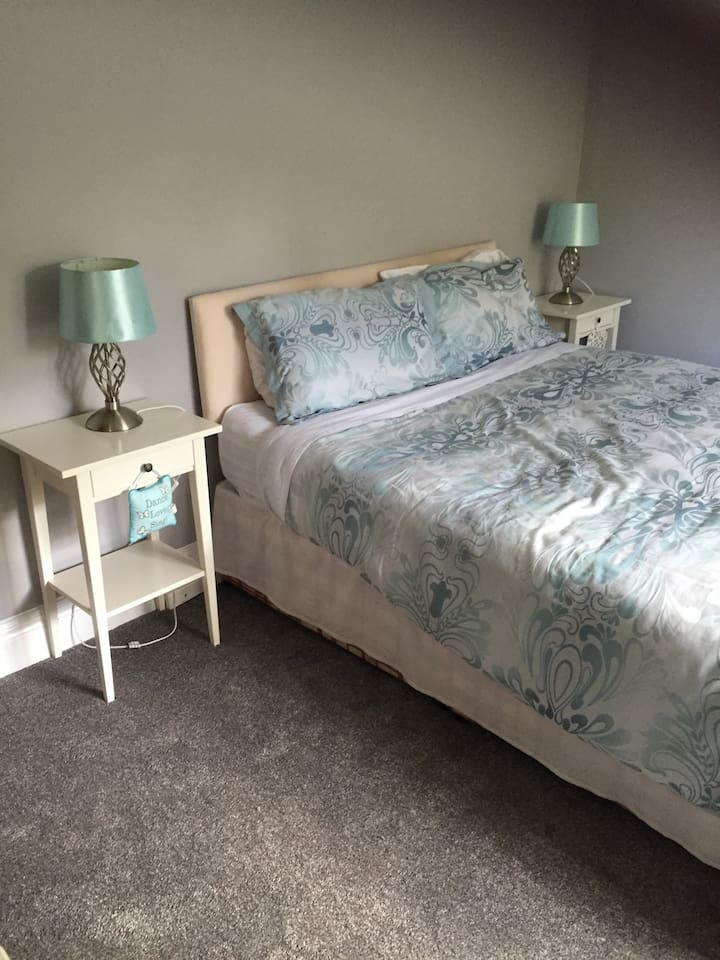 Comfy Kingsize bed with quality bedding in newly refurbished bright airy room. Bedside tables with lamps, chest drawers , dressing table and comfy chair complete this delightful room.