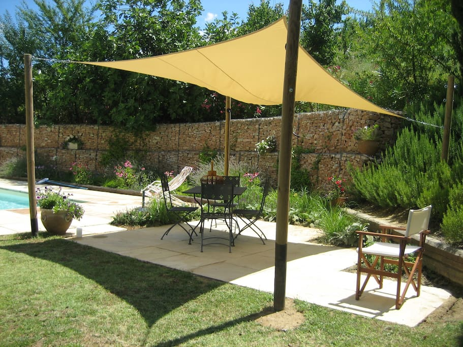 Covered dining area with BBQ