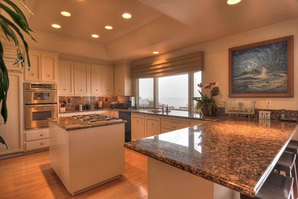 Gourmet Kitchen with Center Island, SS Appliances & Ocean View
