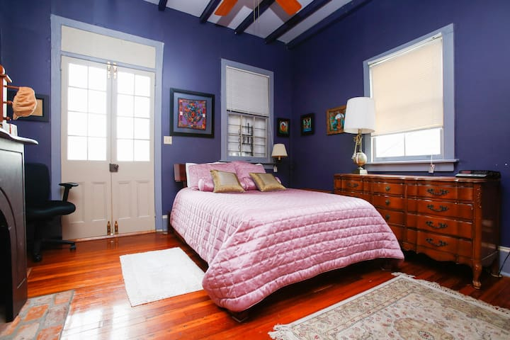 The master bedroom with queen bed also opens up to the front balcony.
