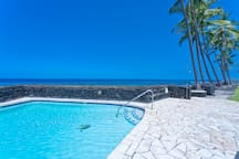Swim in a clear aqua pool and listen to the ocean waves below.