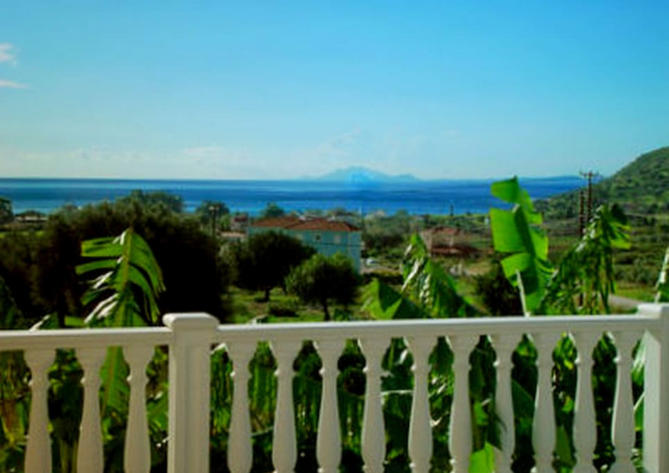 Enjoying the mesmerazing view from Stefanos and Dionysia's balcony, where your breakfast is served.