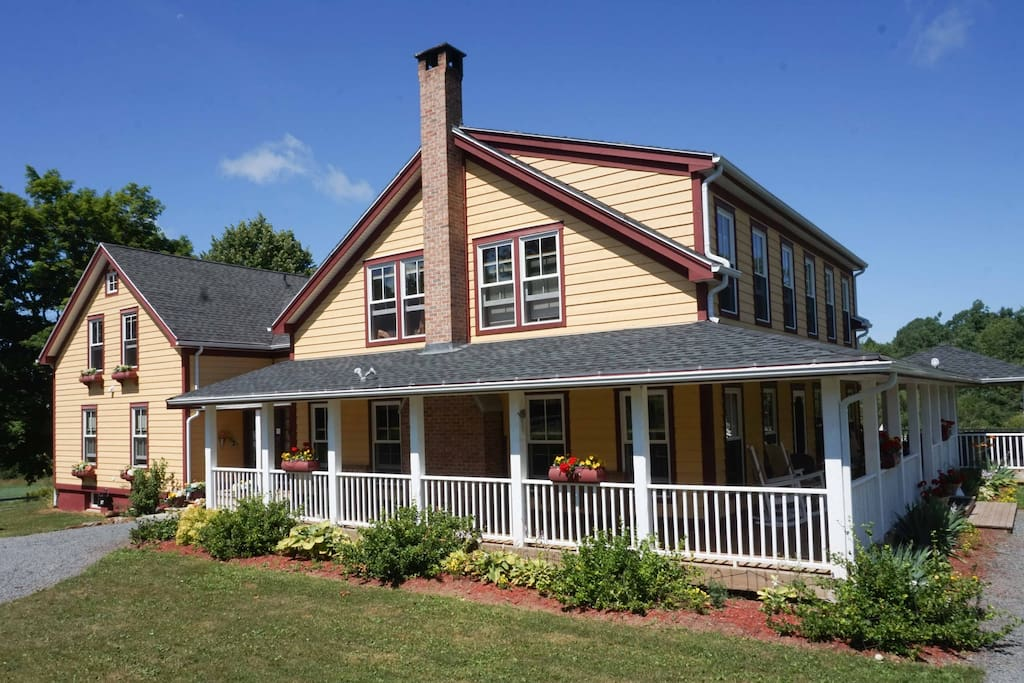 Farmhouse is wrapped with deck and gardens for you to enjoy