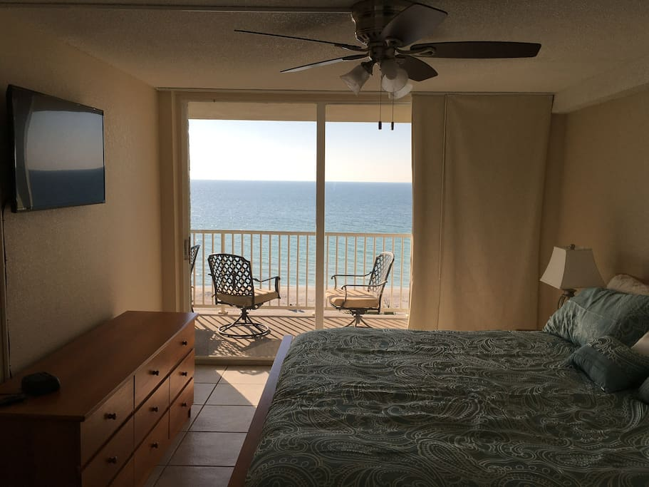 Master bedroom overlooking gulf of Mexico with attached balcony