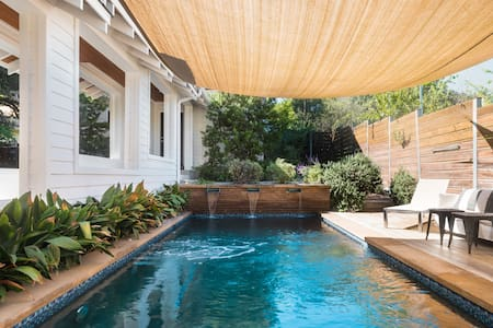 Take in a Dip in the Heated Pool at a Luxury SoCo Retreat