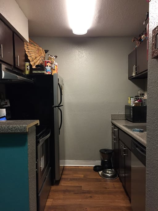 Kitchen includes fridge, oven/stovetop, coffee machine, dish washer, microwave, all eatery/cooking basics.
