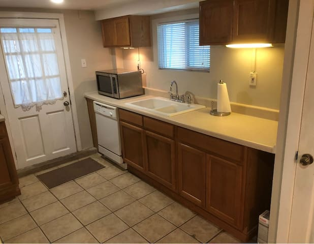 Kitchen with Dishwasher and Microwave.