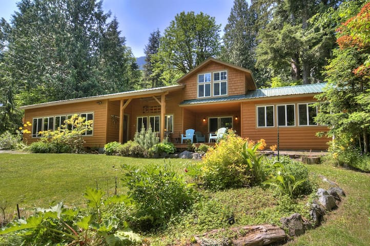 Luxury Riverfront Escape w/ Mountain View! All the Amenities Plus a Hot Tub!