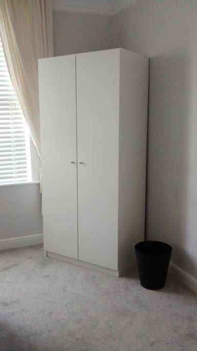 Double wardrobe with hangers to store your clothes.