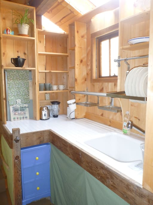 Cabin kitchen is fully equipped for you to cook your own meals.