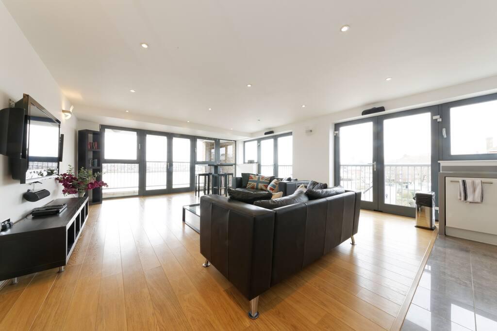 Huge open plan lounge with floor to ceiling windows!