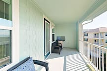 The 3rd floor balcony is accessible from the living area and master bedroom.