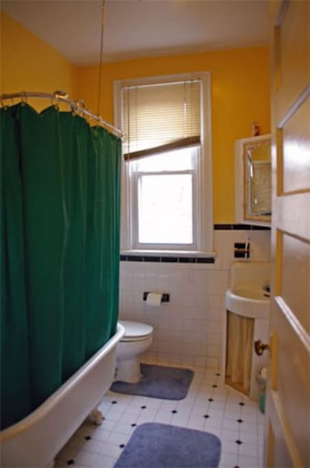 Shared bathroom with original clawfoot tub.