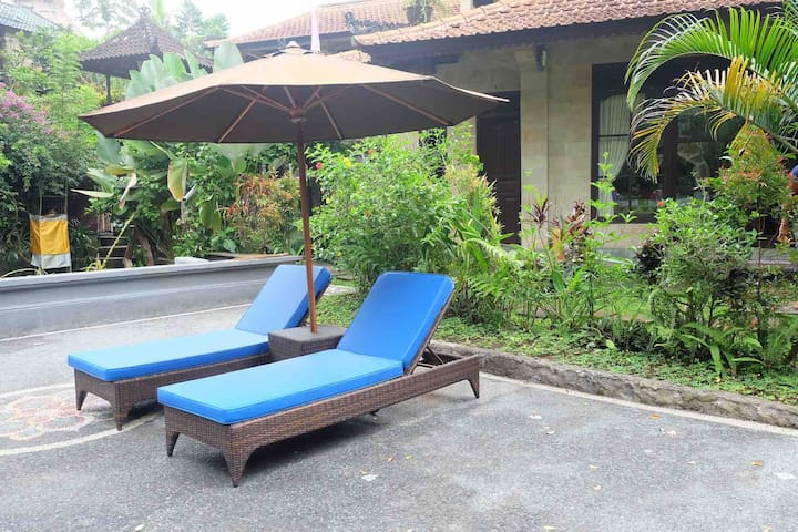 Enjoy your day in your own verandah complete with sunbathing bed and umbrella overlooking to the jungle view