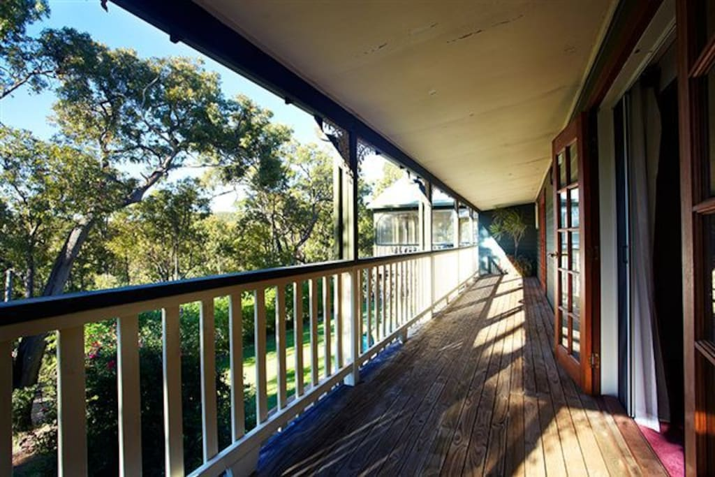 Verandahs wrap around property from guest rooms overlooking beautiful forest