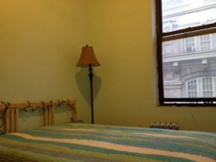 Bedroom with view of street and park - gets amazing light!!