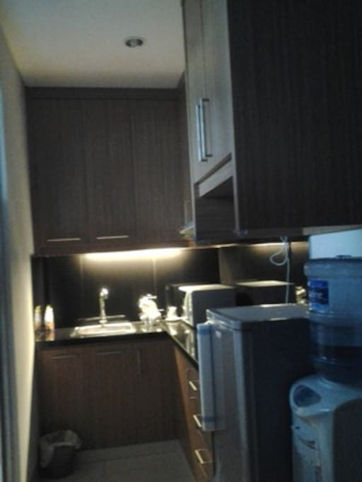 Small cozy kitchen for the studio apartment room at 3rd floor
