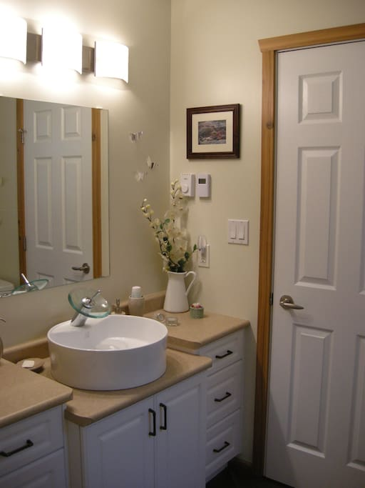 Main Floor Guest Room has Private 4-piece Ensuite Bath