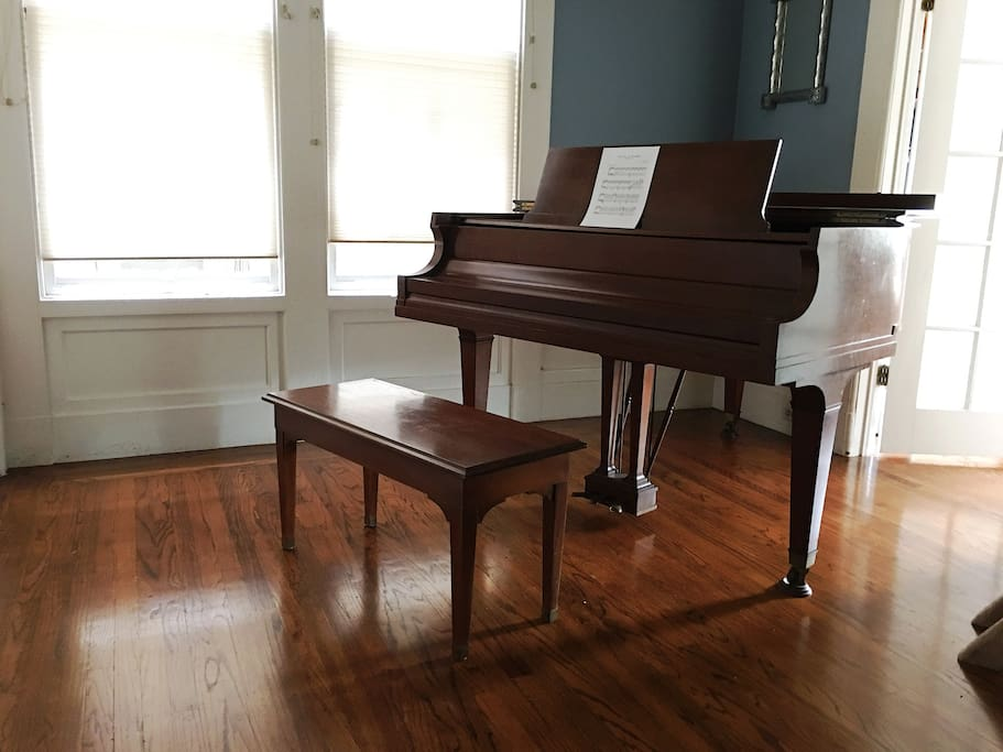 I also do have a baby grand that lives in the middle room (the room that houses the private bathroom as well).