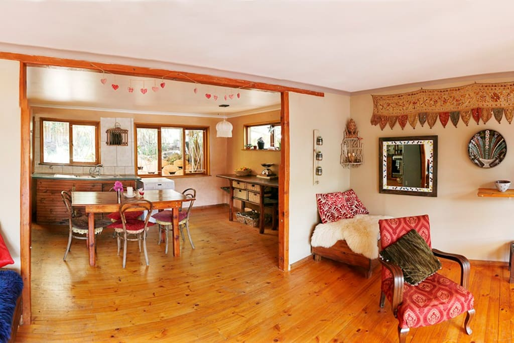 Open plan cottage style kitchen with dining area leading onto lounge with views