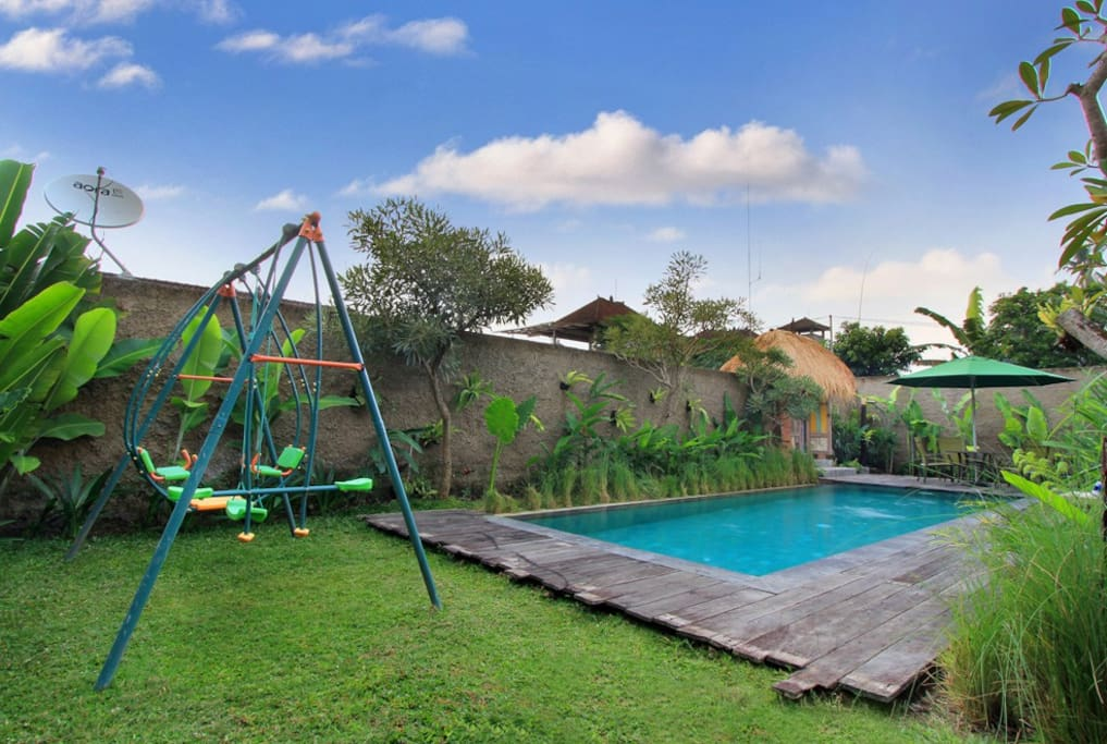 Private Swimming Pool with children swings