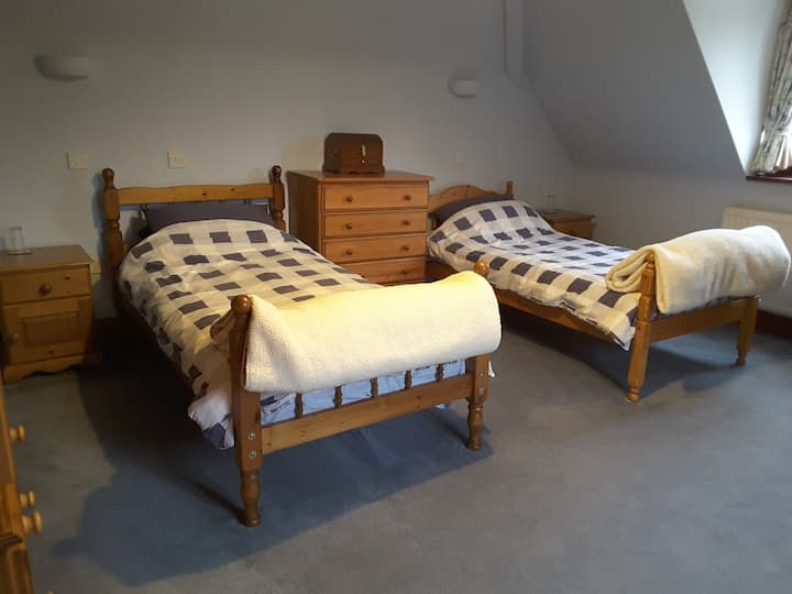 Large twin bedded room with en suite and parking