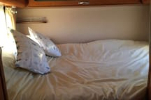 Extremely comfortable bed - all linen provided. Useful storage all around bed