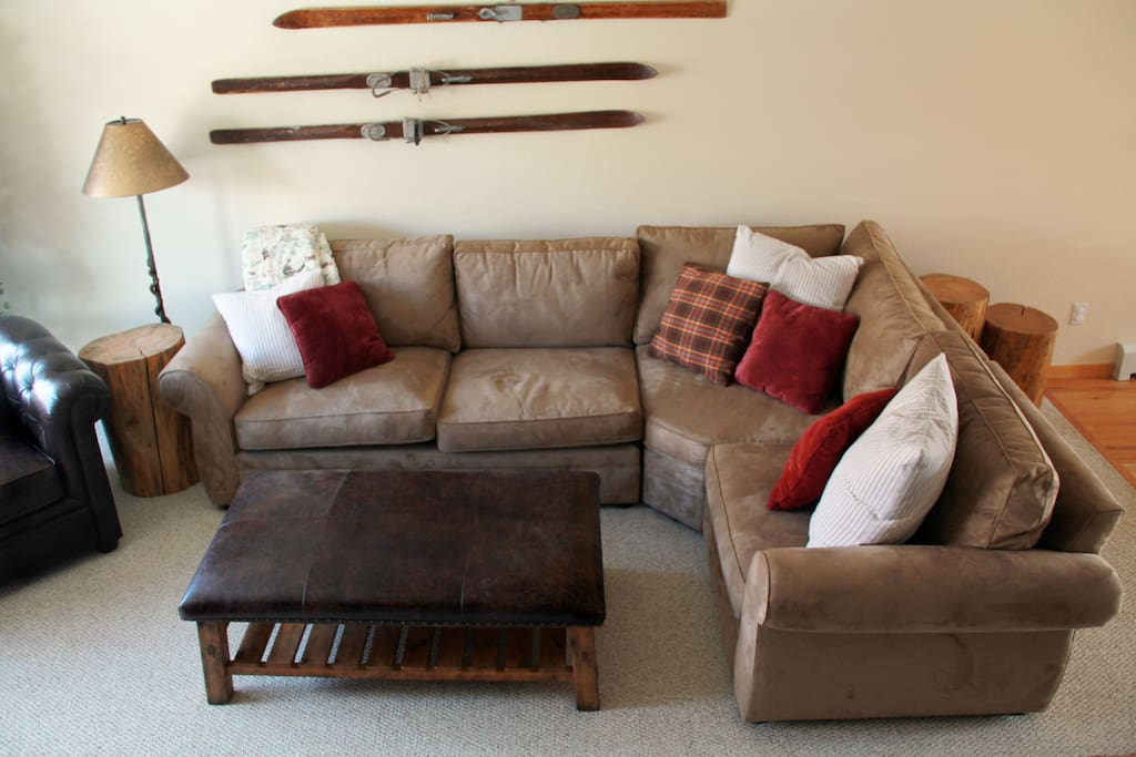 Super cozy couch & leather ottoman.