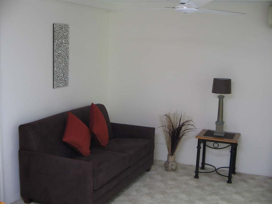 Lounge room, large TV, DVDs, air conditioned. Opens onto your patio.
