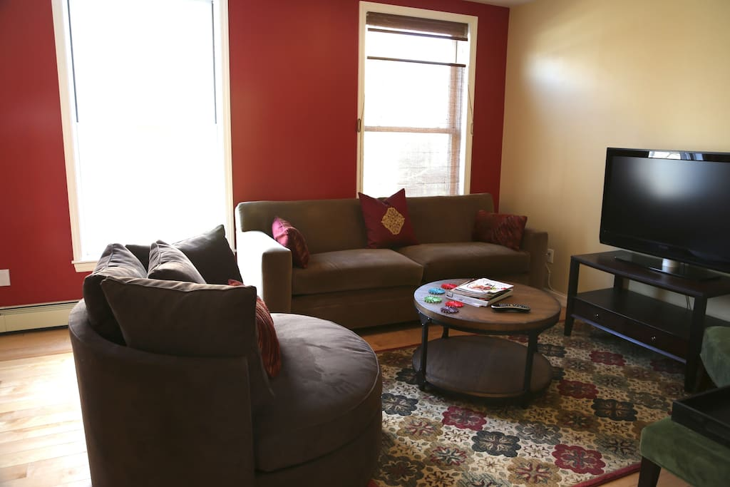 A close up of the lounging area in the living room...cozy, high-quality seating and a 42 inch LCD TV. (older carpet shown here — upgraded to red wool one, which you'll see in other photos.)