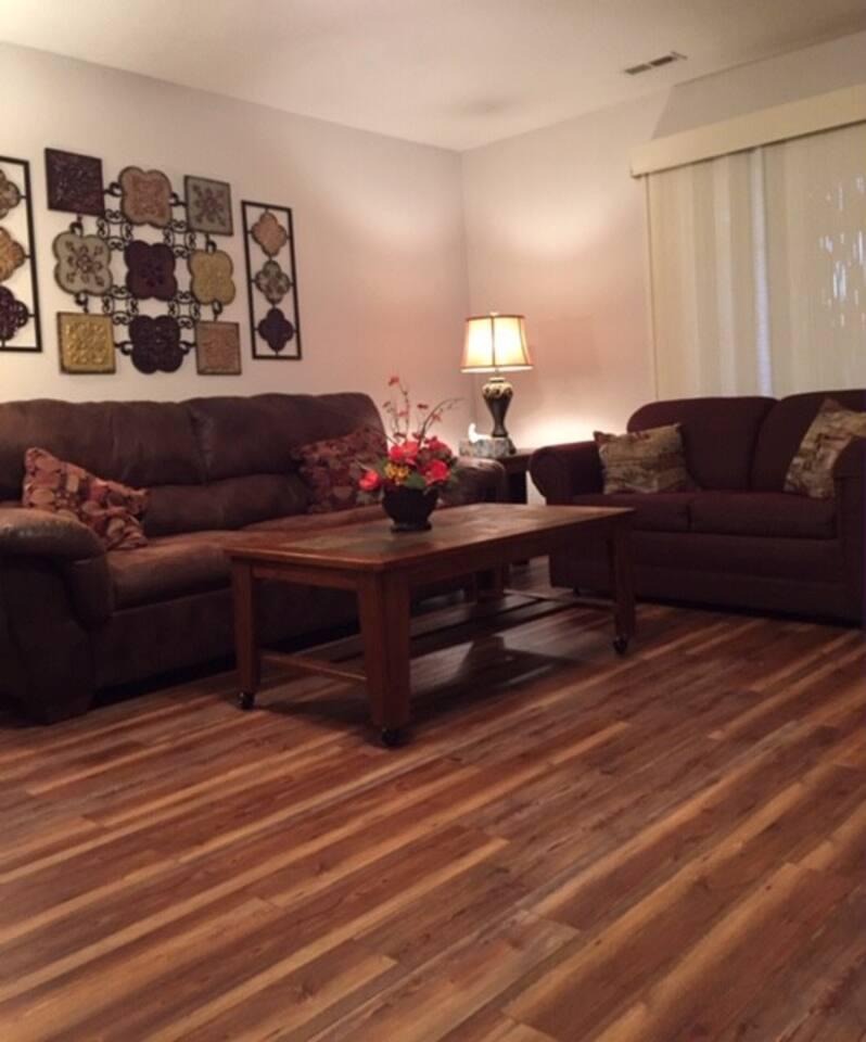 Living room offers plenty of seating.