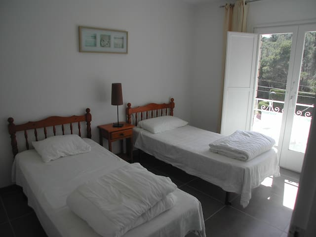 Bedroom with single beds on first floo.
