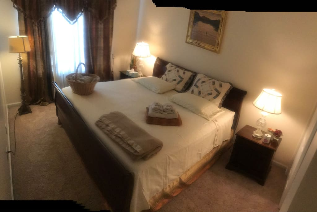 This is a second bedroom in a house with a king size mattress too
